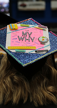 "Graduation hat with ""My Why"" decoration on the top."